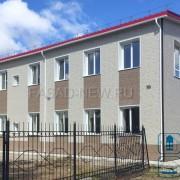 Внешнее утепление дома из кирпича с облицовкой фасада фиброцементными панелями НИТИХА толщиной 14 мм под камень WFX321 и WFX323. Владивосток 2017
