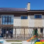 Фото фасада с отделкой фасадными панелями NICHIHA под штукатурку (EPA386), под камень (EJB5123EJB513), под дерево (EPS494). Владивосток 2017