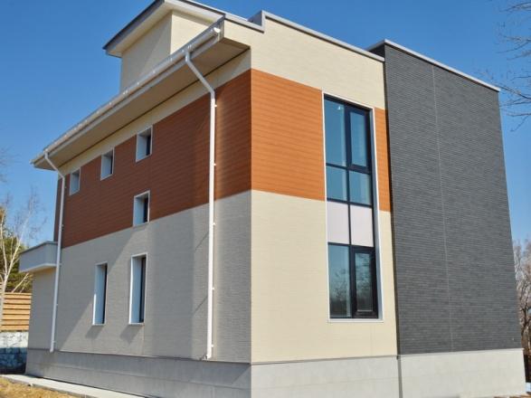 Фиброцеметные панели NICHIHA для отделки фасада дома