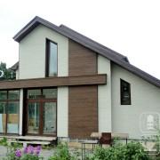 Фасадные панели под камень и дерево для каркасно-щитового дома.