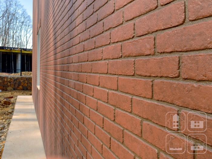 Навесной фасад из фиброцемента с облицовкой «под кирпич»