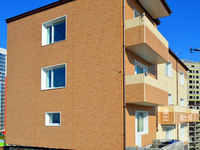 Аккуратный облик жилого дома создан фасадами Nichiha